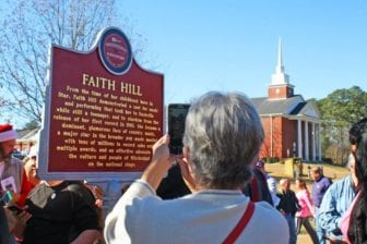People gathered for the unveiling of the Mississippi Country Music Trail's 30th marker, honoring Faith Hill, on Saturday, Dec. 19, 2015, at the corner of Main and Mangum Streets in Star, Miss.