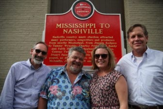 From left, Malcolm White, Craig Wiseman, Mary Margaret Miller White and Americana Music Triangle founder Aubrey Preston stand in front of the Nashville marker.