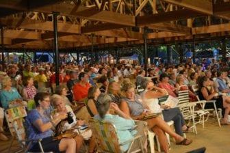A crowd enjoys a live performance of Thacker Mountain Radio at the Neshoba County Fair.