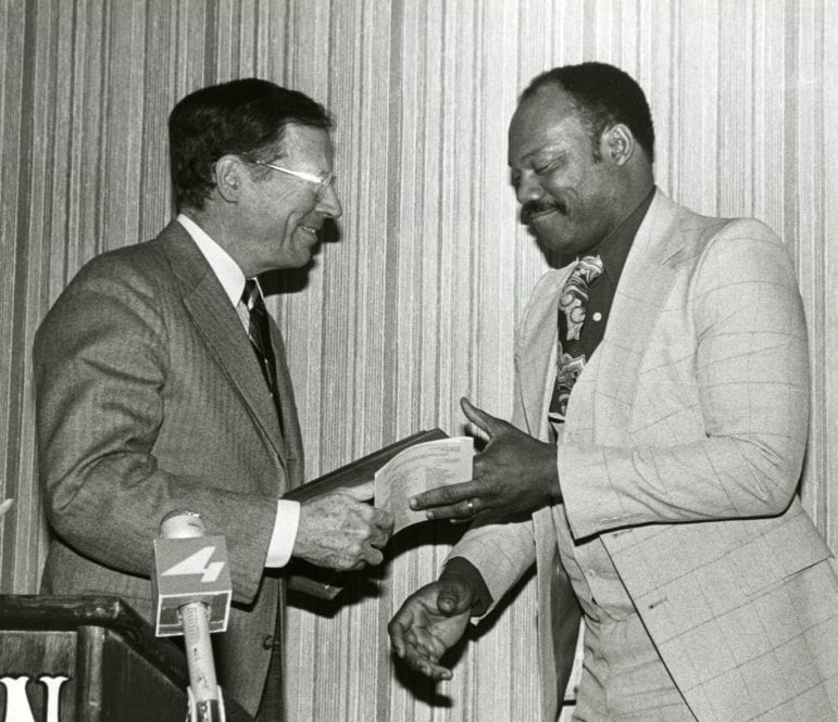 Then-Gov. William Winter makes a presentation to football star Willie Richardson at his 1979 induction into the Mississippi Sports Hall of Fame.