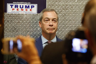 U.K. Brexit proponent Nigel Farage gets on an elevator on Saturday at Trump Tower on his way to a meeting with President-elect Donald Trump.