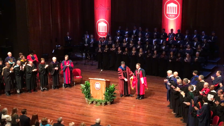 University of Mississippi Provost Morris H. Stocks, left, welcomes Chancellor Jeffrey Vitter to the stage during Thursday's investiture ceremony.