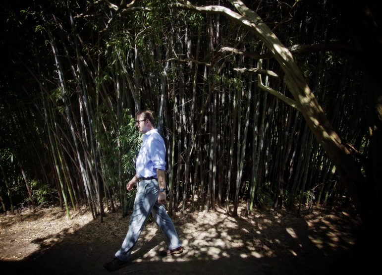 Author Richard Grant walks through a patch of bamboo at his former home in Pluto.