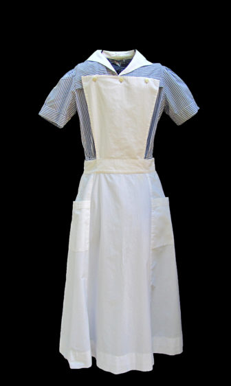 An old-fashioned nurse's apron, one of many aprons that may be viewed at The Apron Museum in Iuka.