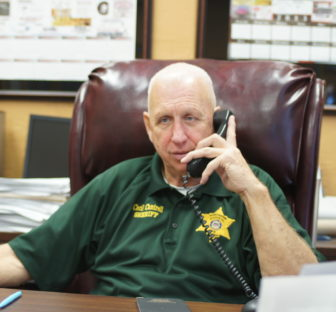 Monroe County Sheriff Cecil Cantrell takes a phone call from the mother of an inmate who called to ask about the availability of drug treatment programs.